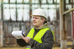 Electrical Engineer with folder stock images