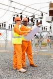Electrical engineer holding blueprint stock photo