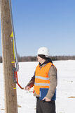 Electrical engineer inspect electric line Stock Photos