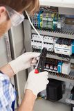 Electrical engineer repairing fusebox Royalty Free Stock Images
