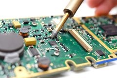 Electrical Engineer is soldering on printed circuit board Royalty Free Stock Photography