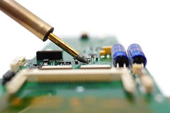 Electrical Engineer is soldering on printed circuit board Royalty Free Stock Photo