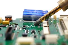 Electrical Engineer is soldering on printed circuit board Royalty Free Stock Images