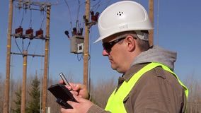 Electrical engineer with tabled PC and cell phone at outdoors stock video