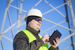 Electrical Engineer with tablet PC. At outdoor Royalty Free Stock Photos