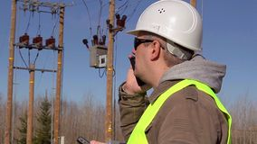 Electrical engineer talking on cell phone at outdoors stock footage