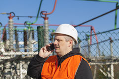 Electrical engineer talking on the phone stock images