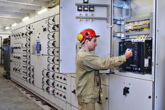 Electrical engineer uses equipment of the switchboard. Royalty Free Stock Photos