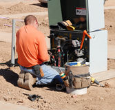 Electrical Engineer Working. On mains system for new home development stock image