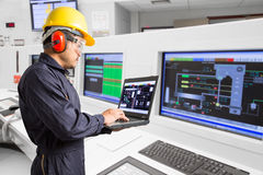 Electrical engineer working at control room of powerhouse stock photography
