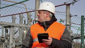 Electrical engineer working with tablet PC at power plant stock footage