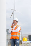 Electrical engineer working in wind turbine power generator royalty free stock images