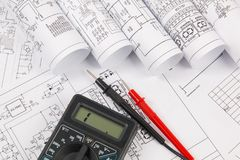Electrical engineering drawings and digital multimeter Royalty Free Stock Photo