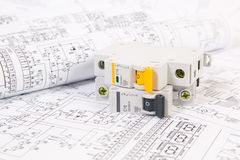 Electrical engineering drawings and modular circuit breaker. stock image