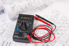 Electrical engineering drawings and multimeter. Electrical engineering drawings and digital multimeter Royalty Free Stock Photo