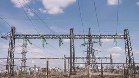 Electrical engineering structures at a power plant. High-voltage wires on supports. power lines. Distribution and. Transportation of electricity stock footage