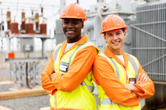 Electrical engineers arms crossed royalty free stock photography