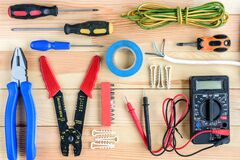 Free Electrical Equipment And Tools On Wooden Table. Stock Photo - 190566430