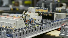 Electrical equipment, control system of a modern CNC machine. Electrical modules and cables are mounted on the circuit board stock video
