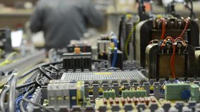Electrical equipment, control system of a modern CNC machine. Electrical modules and cables are mounted on the circuit board stock footage