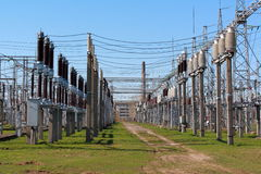 Electrical equipment in switchyard. Rows of electrical equipment in switchyard Royalty Free Stock Images