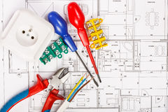 Electrical equipment. And tools on house plans stock photos