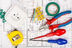 Electrical equipment. And tools on house plans stock photo
