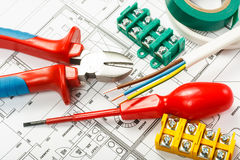 Electrical equipment. And tools on house plans Royalty Free Stock Photography