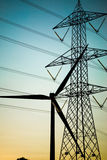 Electrical equipments. Electric supply equipments silhouetted against the sky at the sunset Royalty Free Stock Image
