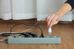 Electrical extension cord. With electric plug on the wooden floor. Concept of energy saving Stock Image