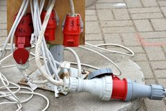 Electrical extension cord with plugs. Extension lead. Electric extension cord on ground stock photography