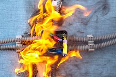 Defective electrical wiring cause of  fire at home. Electrical fire dangers at home. Electrical system burn out because of faulty wires. Burned wires are cause royalty free stock images