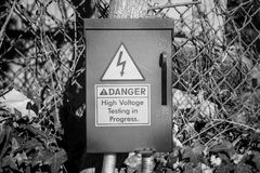 An electrical fuse box with a danger warning Royalty Free Stock Photography