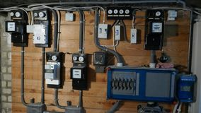 Electrical fuse boxes and power lines in the basement of an old apartment building stock photo
