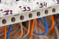 Electrical fuseboxes and power lines Royalty Free Stock Photo