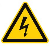Electrical Hazard High Voltage Sign Isolated Macro. Danger Electrical Hazard High Voltage Sign Isolated, black triangle over yellow, large macro stock images