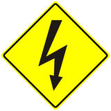Electrical hazard high voltage sign isolated macro. Danger electrical hazard high voltage. Yellow sign Royalty Free Stock Photography