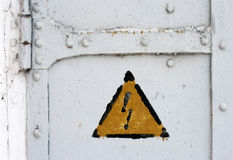 Electrical hazard symbol on iron door Royalty Free Stock Photo