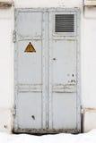 Electrical hazard symbol on iron door Royalty Free Stock Photo
