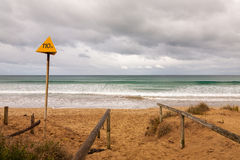 Electrical hazard warning sign at the beach Stock Image