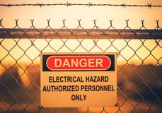 Electrical Hazard Warning Sign. On Metal Fence. Authorized Personnel Only stock photos