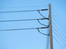Electrical high voltage pole with blue sky. Stock Images
