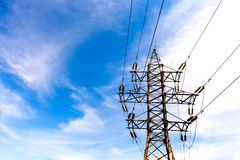 Electrical high voltage tower on blue sky background Stock Images