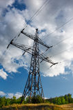 Electrical industry on blue cloudy sky at summertime Stock Photos
