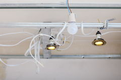 Electrical installation at construction site. Installing energy light Stock Photography