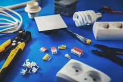 electrical installation - electrician tools and equipment on blue royalty free stock photography