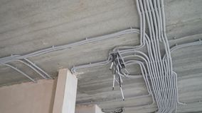 Electrical installation of plastic electrification tubes on building site. Electrical installation of plastic tubes on building site. Fix boxes, fire prevention stock video footage