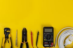 Electrical installation tools on yellow background. With copy space royalty free stock images