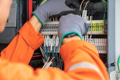 Electrical and instrument technician wiring cable at terminal and junction box. Electrical and instrument technician wiring cable at terminal and junction box Stock Image