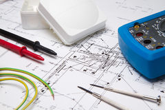 Electrical instruments laying on blueprint Stock Images